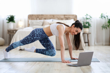 Home Workout. Young Asian Girl Practicing Sport In Front Of Laptop