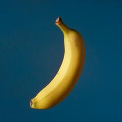 Fruit pop art yellow banana blue color background art side lighting