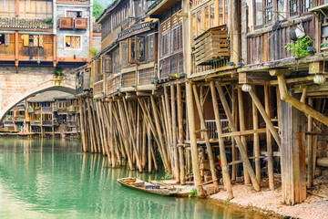 Old authentic traditional Chinese wooden riverside houses