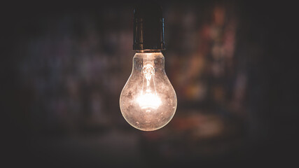 Close-up Of Illuminated Light Bulb Indoors