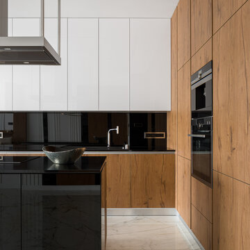 White, black and wooden kitchen