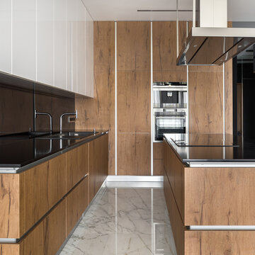 Kitchen with wooden cupboards and wall