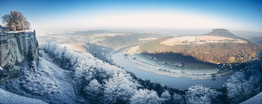 Festung Königstein fortress in saxony in winter with frozen landscape and river elbe