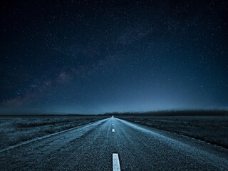Sky full of stars over the empty highway at night