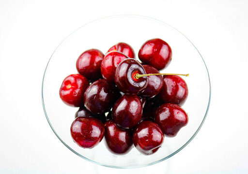 Freshly Washed Cherries in a Martini Glass