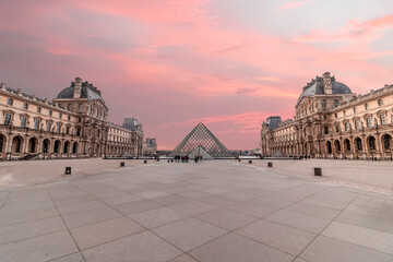 Paris, France - March 15, 2018: View of iconic Palace of Louvre and the pyramid of Louvre museum at sunset
