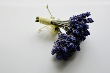 2 bundles of dried lavender on a white background