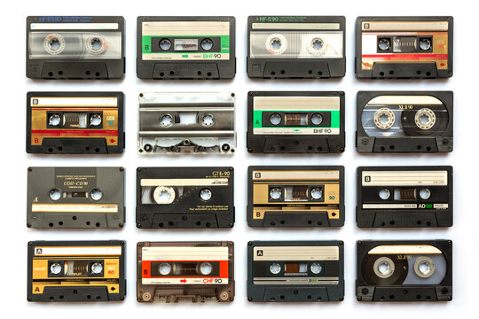 Collection of old audio cassette tapes isolated on white background, vintage music and technology concept