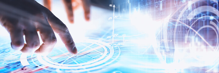 Business concept. Information technology and data processing. Hands over the screen with graphic data. A modern software product in business.