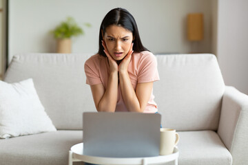 Shocked Woman At Laptop Having Bad Internet Connection At Home