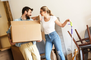 Young married couple moving into new home.