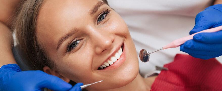 Close up of young woman having dental check up in dental office. Dentistry. Macro shot
