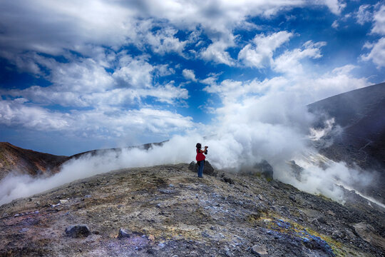 Taking pictures on Vulcano island ( Aeolian islands) day trip, Sicily, Italy