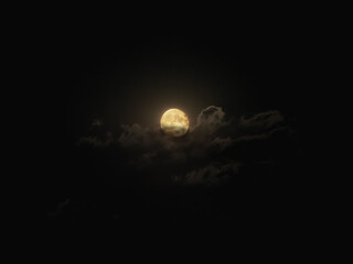 Full moon lighting up clouds