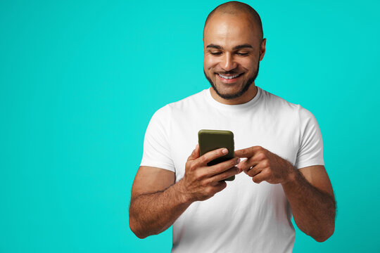 Young african american man making video call with his smartphone