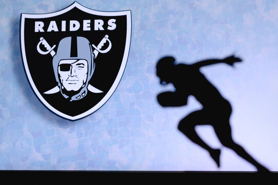 Las Vegas Raiders. Silhouette of professional american football player. Logo of NFL club in background, edit space.