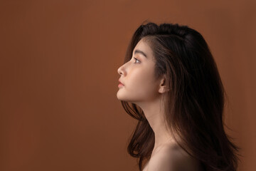 Beautiful asian woman with a beautiful face . Side view