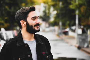 Smiling Bearded Man Looking Away At Street