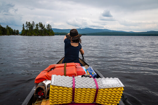 Paddling a canoe to an island in north western Maine.
