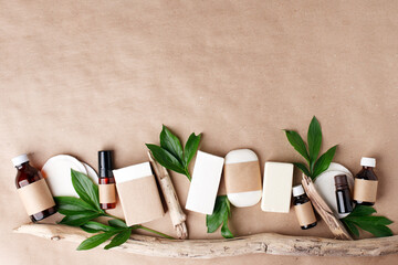 Obraz Zero waste natural cosmetics products on craft paper table. Flat lay, organic solid soap and shampoo bars, antibacterial handcrafted soap concept, mock up, organic detail, leaves - fototapety do salonu
