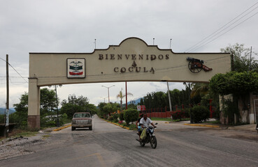"""A general view shows a signs """"Welcome Cocula"""" the town where the remains of one of the 43 missing students from Ayotzinapa were found, at the mountain town of Cocula"""
