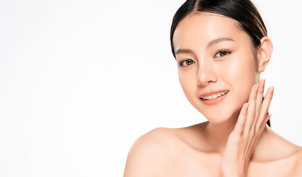 close up Beautiful Young asian Woman touching her clean face with fresh Healthy Skin, isolated on white background, Beauty Cosmetics and Facial treatment Concept