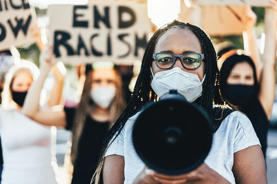 People from different ages and races protest on the street for equal rights - Demonstrators wearing face masks during black lives matter fight campaign - Focus on woman face