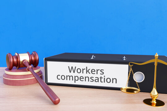 Workers compensation. File Folder with labeling, gavel and libra. Law, judgement, lawyer