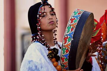 Fototapeta Woman Wearing Traditional Clothing Holding Drum obraz