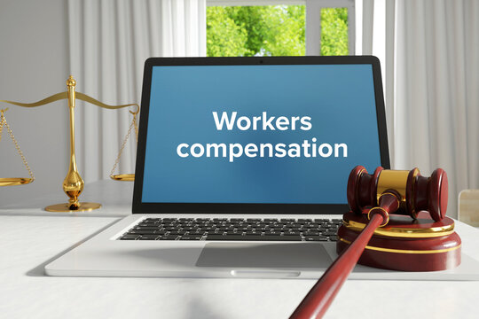 Workers compensation. Law. A lawyer laptop on a desk in the office. Text on the screen. Libra, Juctice, Web