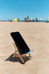 smartphone in a deck chair on the beach