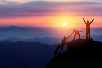 Teamwork friendship hiking help each other trust assistance silhouette in mountains, sunrise. Teamwork of two men hiker helping each other on top of mountain climbing team beautiful sunrise landscape