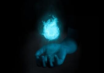 Fotomurales - Digital Composite Image Of Hand Holding Illuminated Light