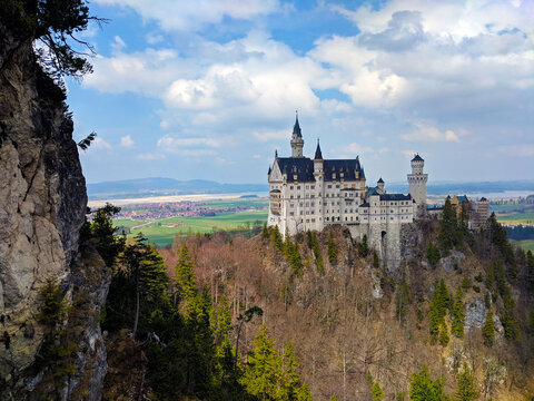 Neuschwanstein Castle atop a Mountain