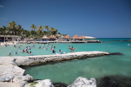 People are snorkeling in Caribbean Sea at Xcaret, playa del carmen Mexico