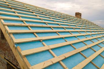 Obraz Brick house with wooden roof frame under construction. - fototapety do salonu