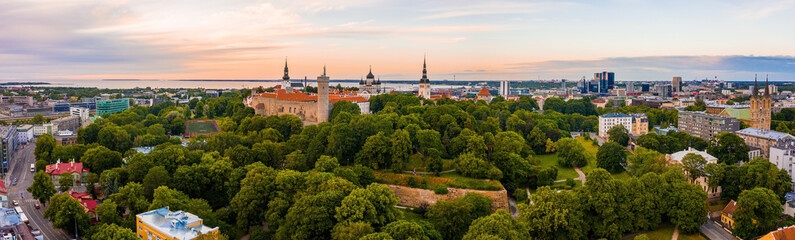 Tallinn is a medieval city in Estonia in the Baltics. Aerial view of the old town of Tallinn with orange roofs and narrow streets below.