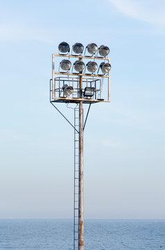 Spot light lamp system on blue sky background.