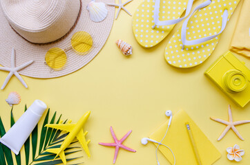 Summer holiday Vacation border frame mockup. Top view beach accessories on a yellow background....