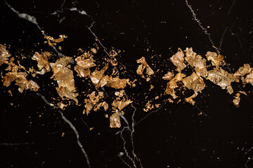 gold leaf petals on black marble