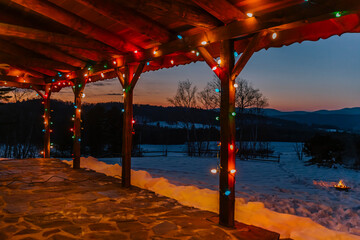 Porch of Log Cabin in Vermont with Winter Christmas Lights