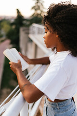 side view of a african woman reading a book