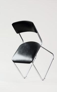 Vintage 1970 tubular steel chair balancing