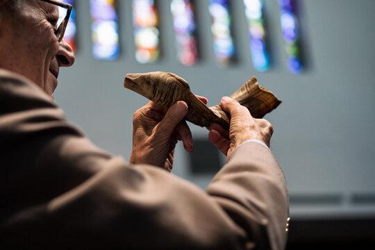 Synagogue: Senior Man Ready To Blow Shofar During Service
