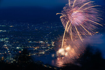 Fireworks at Local City in Japanese Countryside Beside the Lake Surrounded Mountains