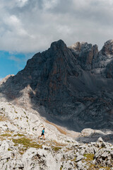 Trail runner working out downhill in Picos de Europa National Park