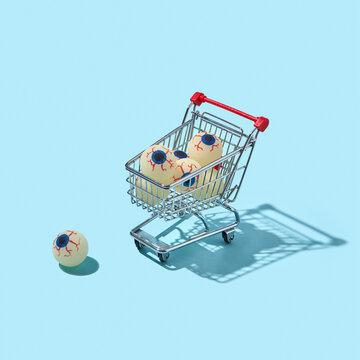 Shopping trolley with eyeballs.