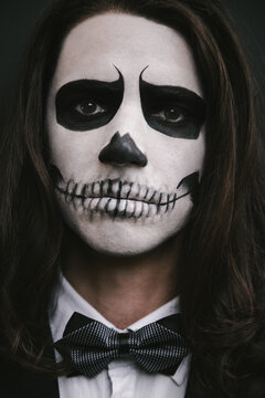 portrait of young man with skull Halloween facepaint