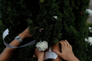 Family members hang flowers from trees in remembrance of people who died from the coronavirus disease (COVID-19), at a nursing home in Leganes, near Madrid
