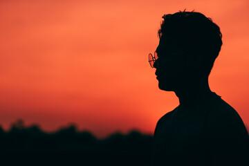 Portrait Of Silhouette Man Against Orange Sky